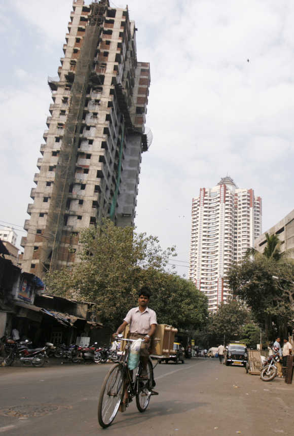 A man cycles past newly constructed buildings in Mumbai. Photo is for representation purposes only.