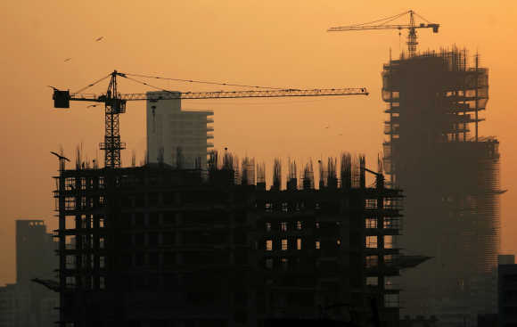 Buildings under construction are seen along the Mumbai skyline.