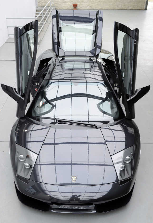 A Lamborghini Murcielago car is displayed in the showroom in downtown Milan.