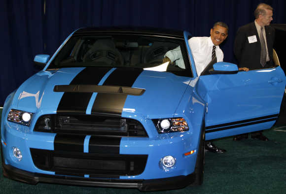 US President Barack Obama sits in a Ford Mustang Shelby GT-500 at the 2012 Washington Auto Show at the Walter E Washington Convention Center in Washington.
