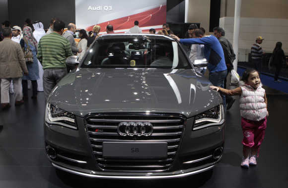 Visitor look on at the Audi S8 at the Qatar International Motor Show in Doha.