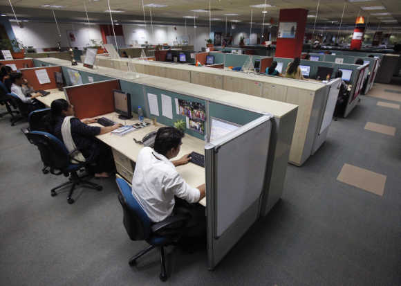 Employees working at an outsourcing company in Mumbai.