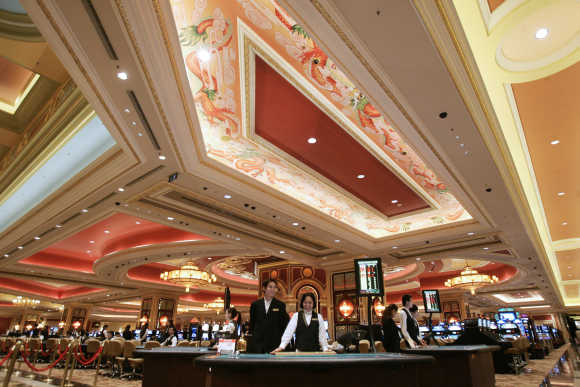 Employees stand by in the casino at the Venetian in Macau.