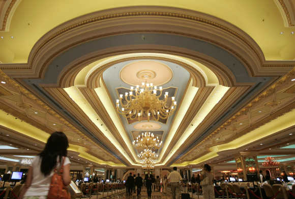 Visitors walk in the casino at the Venetian in Macau.