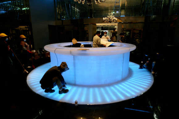Workers put on the last touches to a restaurant in the MGM Grand Macau hotel in Macau.