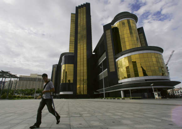 A man walks outside Sands hotel in Macau.