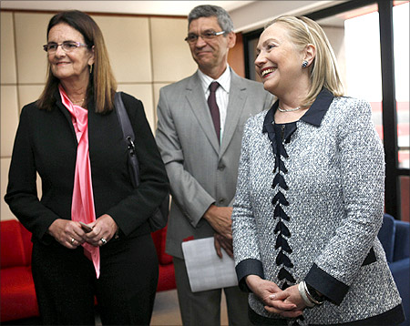 -U.S. Secretary of State Hillary Clinton (R) meets with the CEO of Brazil's state oil company Petroleo Brasileiro Maria das Gracas Silva Foster (L) in Brasilia.