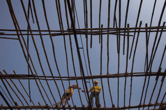 Labourers work on erecting bamboo scaffolding at a construction site in Mumbai. Photo is for representation purpose only.
