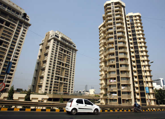 A vehicle drives past residential buildings in Mumbai. Photo is for representation purpose only.