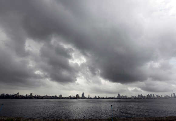 A man sits on a seafront against the backdrop of monsoon clouds in Mumbai. Photo is for representation purpose only.