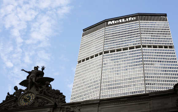 A statue stands atop Grand Central Station in front of the MetLife building in New York.