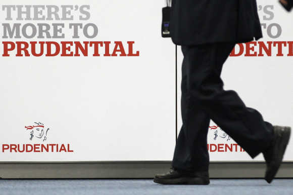 Shareholder arrives at Prudential's annual general meeting in central London.