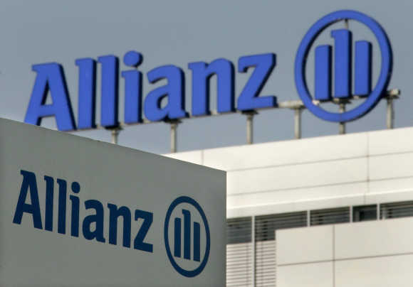 Allianz logos are pictured in front of the headquarter of German insurer Allianz AG in Munich.