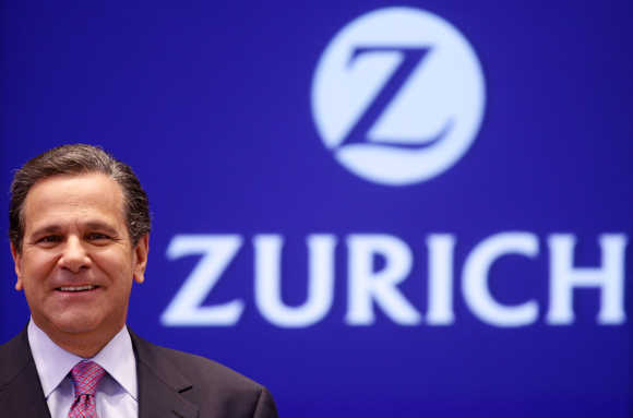 Zurich Financial Services Group CEO James J Schiro smiles as he poses for photographers in Zurich in this file photo.