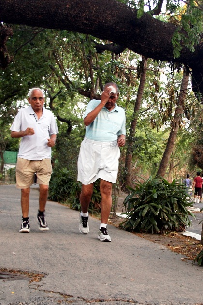 Joggers sweat it out at a Kolkata park.