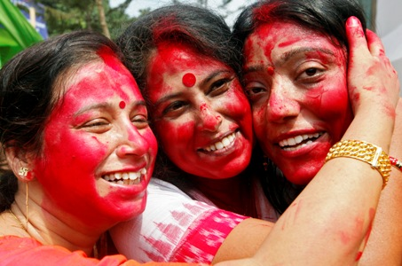 Women pose for a photo after smearing each other with vermillion powder as part of a ritual on the last day of the Durga Puja festival in Kolkata.