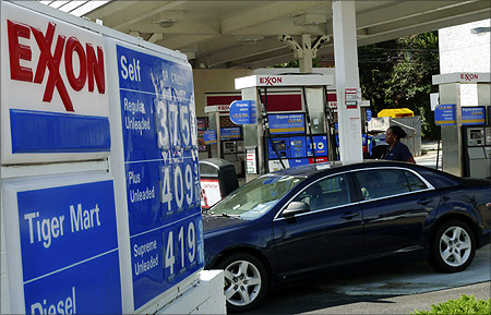 A motorist fills up her car at an Exxon gas station in Arlington, Virginia.