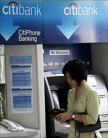 customer leaves Citibank's automated teller machine in Jakarta.