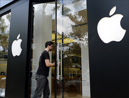 A visitor walks into an Apple store in Clarendon, near Washington.