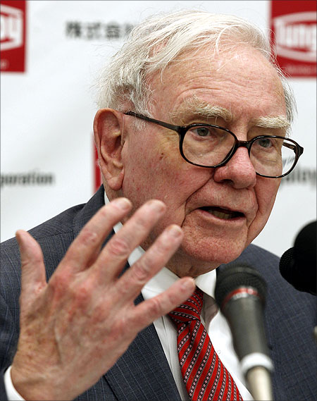 Berkshire Hathaway Chairman Warren Buffett speaks at a news conference.