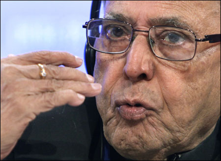 Finance Minister Pranab Mukherjee speaks at a news conference during the spring International Monetary Fund-World Bank meetings in Washington on April 19, 2012.