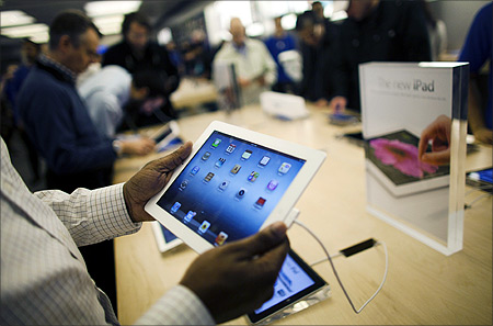 Customers look at the new iPad at the Apple Store in the Eaton Centre shopping mall in Toronto.