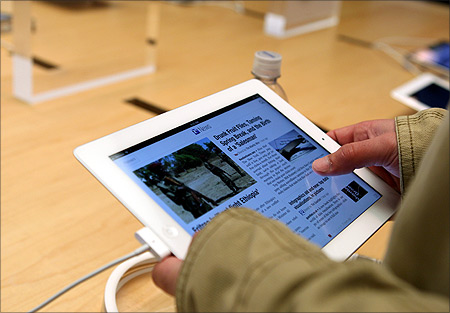 A customer works on the new iPad at the Apple flagship retail store in San Francisco, California.