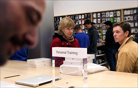 Customers wait for personal training after purchasing the new iPad at the Apple flagship retail store in San Francisco.