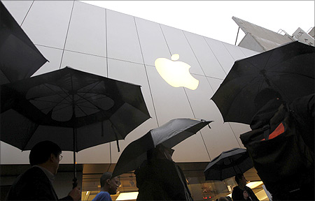 Customers enter the Apple flagship retail store to purchase the new iPad in San Francisco, California.