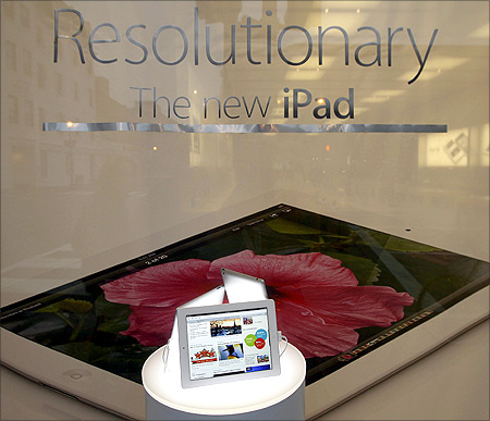 An Apple iPad is pictured in a display window at the Apple Store in Washington.
