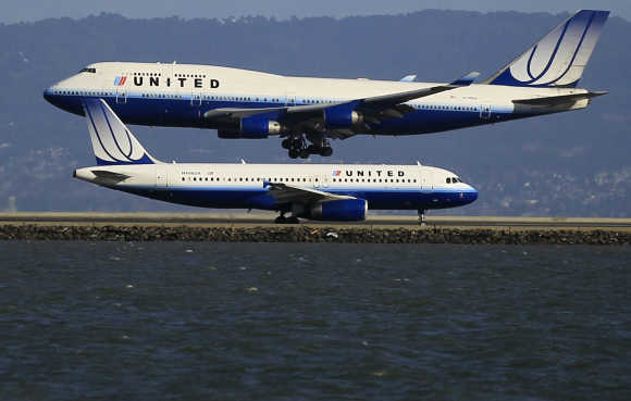 United Airlines planes take off and land at San Francisco airport.