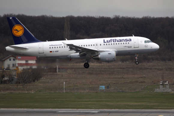 A Lufthansa Airlines Airbus A319 plane prepares to land at Henri Coanda Airport in Otopeni, near Bucharest.