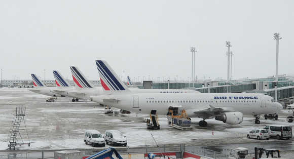Air France planes are seen on the snow covered tarmac at the Charles-de-Gaulle airport in Roissy, near Paris.