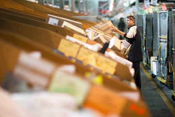 A Swiss postal employee sorts parcels in one of the three main Swiss logistic hubs in Daillens near Lausanne.