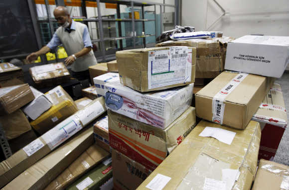 A worker sorts parcels in Turkish Post's postal logistic centre at the Ataturk International airport in Istanbul.