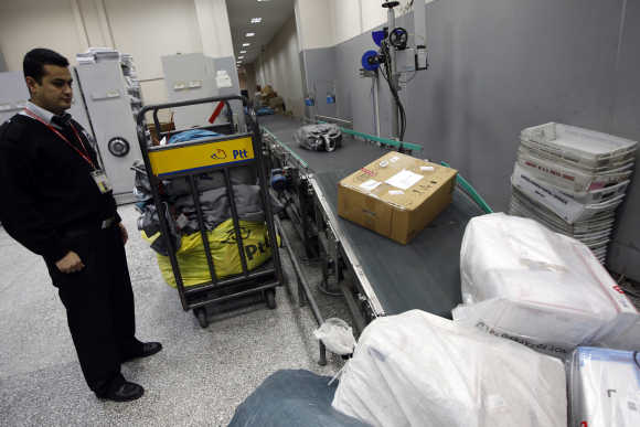 A security personal monitors incoming parcels in Turkish Post's postal logistic centre at the Ataturk International airport in Istanbul.