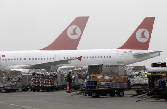 Cargo is offloaded from arriving aeroplanes outside of Turkish Post's postal logistic centre at the Ataturk International airport in Istanbul.