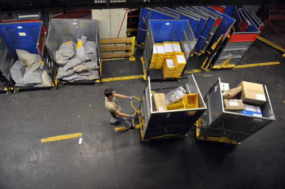 Worker deploys packages in logistic centre in Ljubljana.