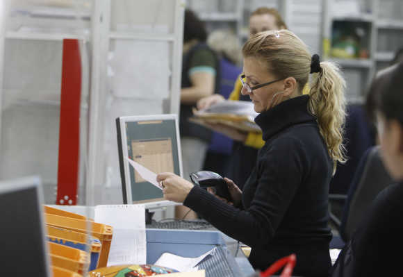 A worker in Bulgaria's main postal logistic centre in Sofia.