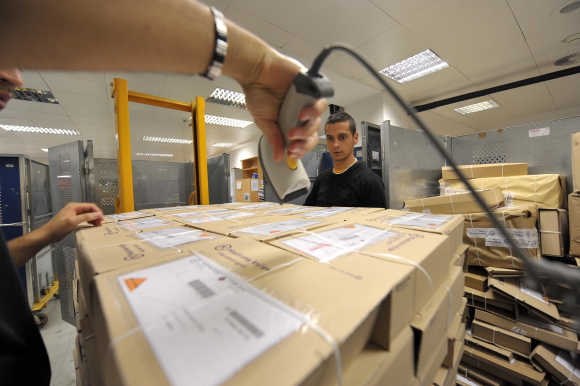 A worker deploys packages in logistic centre in Ljubljana.