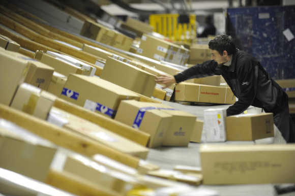 A worker deploys packages in postal logistic centre in Ljubljana.