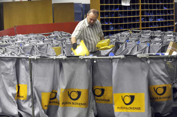A worker sorts mail in Slovenia's main postal logistic centre in Ljubljana.