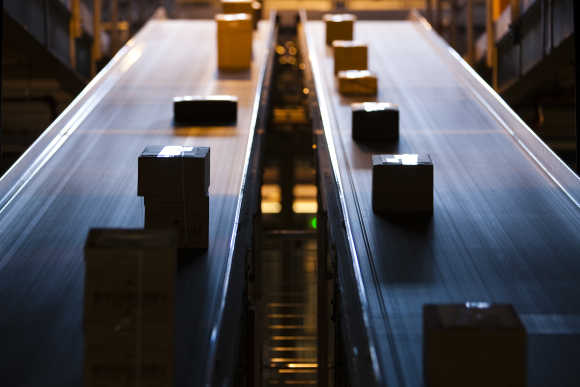 Parcels travel on a conveyer belt before being sorted for delivery in Daillens near Lausanne.