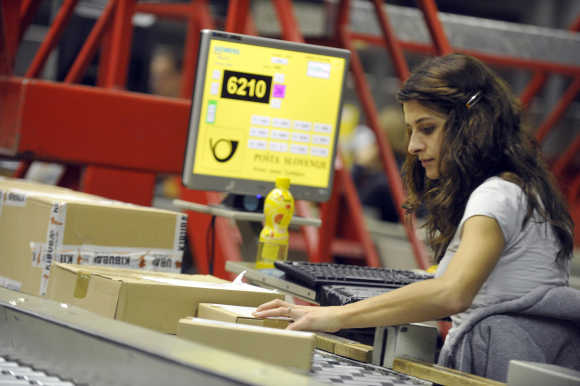 A worker checks mail in logistic centre in Ljubljana.