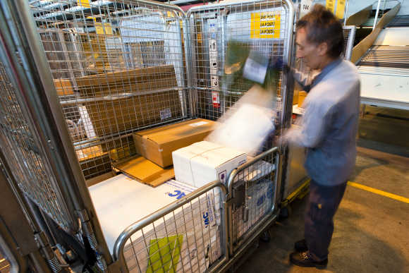 A Swiss post employee sorts parcels in Daillens near Lausanne.