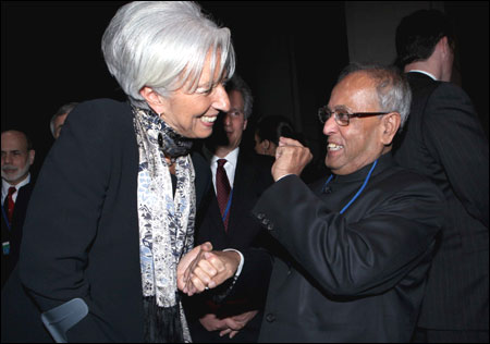 Pranab Mukherjee and Christine Lagarde (left) Managing Director, International Monetary Fund enjoy a lighter moment.