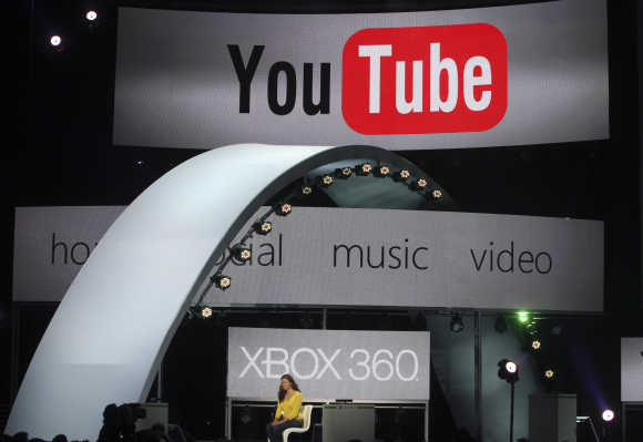 A woman demonstrates YouTube services in Los Angeles.