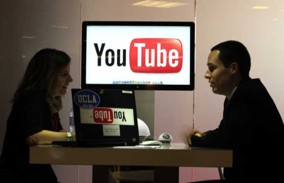Visitors are seen at YouTube stand in Cannes.