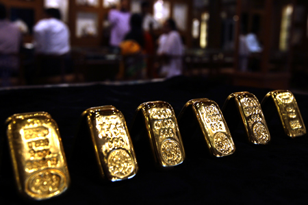 Gold biscuits are displayed inside a jewellery showroom in the southern Indian city of Hyderabad.