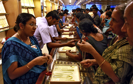 Customers crowd at a gold jewellery showroom on the occasion of Akshaya Tritiya, a major gold buying festival in Kochi.